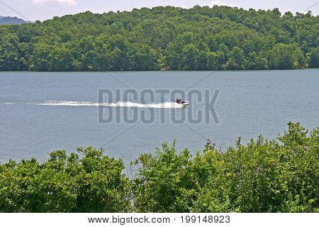 a jet ski races across Lake Chatuge on the North Carolina / Georgia border