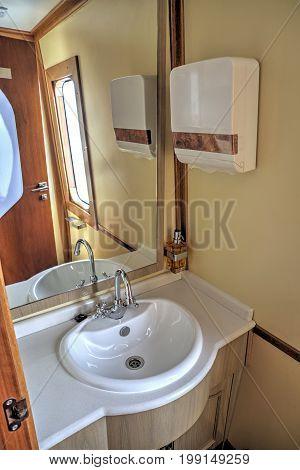 Modern bathroom of a luxurious touristic train, stationed at Latacunga, Ecuador