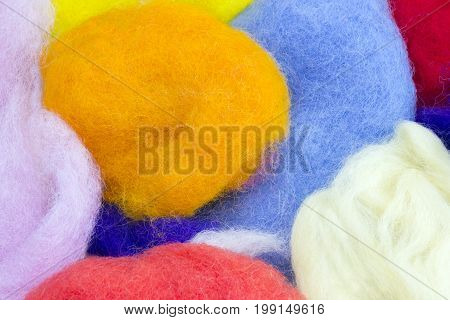 Colorful natural sheep wool for felting. Dry merino bright colorful wool. Blue orange white and yellow dried yarn for the creative craft fashion work