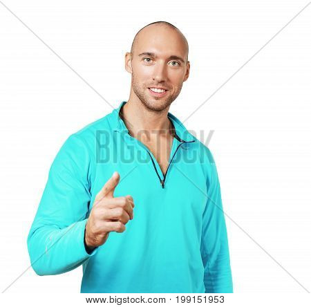 half length portrait of young cheerful man pointing standing next to color backgtound