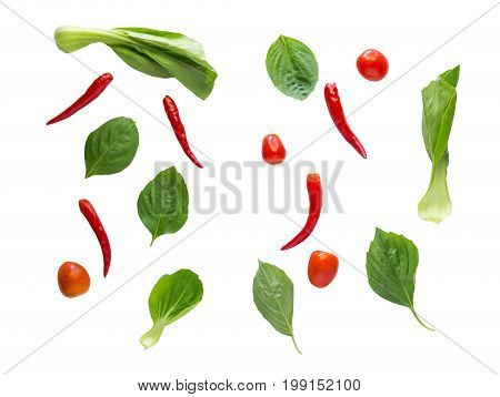 Flay lay vegetables herbs and spices on white background.