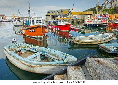 Mevagissey Harbour, Cornwall England, 30th May 2017, small boats in harbour