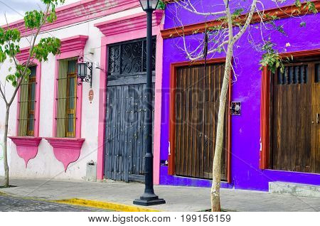 View of pink and blue colonial house in downtown Oaxaca Mexico