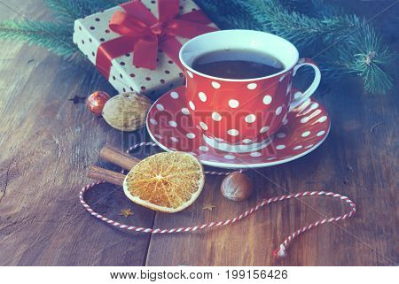 Christmas cup of tea with gift orange nuts and Christmas decor