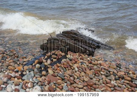 A wooden wreckage of a ship on a Lake Superior beach.  Pictured Rocks National Lakeshore, Upper Peninsula of Michigan