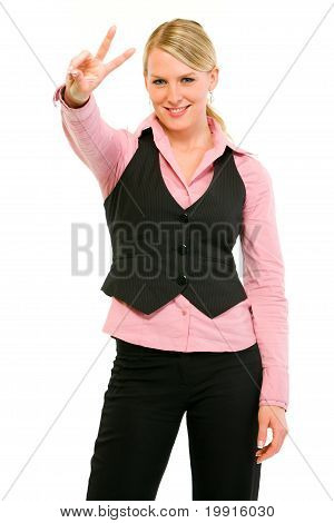 Smiling modern business woman showing victory gesture isolated on white