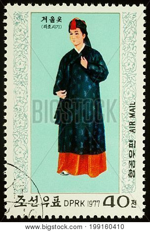 Moscow Russia - August 09 2017: A stamp printed in DPRK (North Korea) shows a woman in traditional Korean costume for winter series