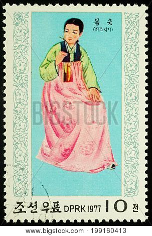 Moscow Russia - August 09 2017: A stamp printed in DPRK (North Korea) shows a woman in traditional Korean dress for spring series