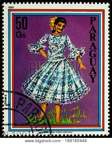 Moscow Russia - August 09 2017: A stamp printed in Paraguay shows beautiful young woman in Paraguayan traditional dress series