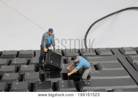 Worker Figurines Posed Look As Though They Work