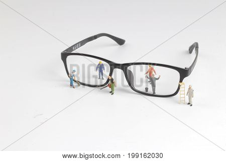 Mini Of Technician Repairing Reading Glasses