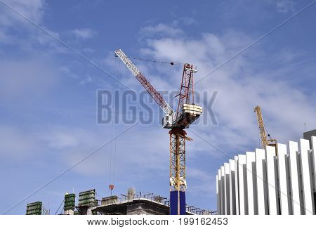 Crane is working on construction site background