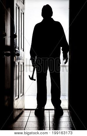 Intruder At Door, In Silhouette With Hammer.