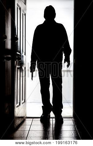 Intruder At Door, In Silhouette With Buck Knife