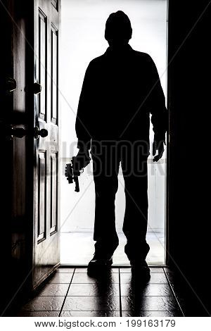 Intruder At Door, In Silhouette With Handgun