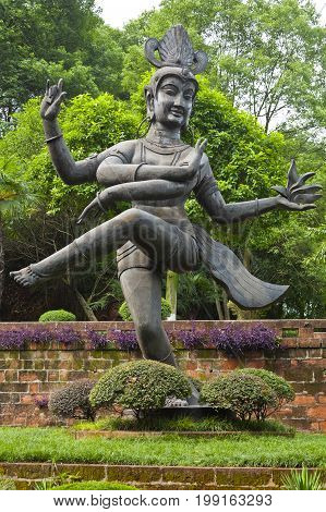august 2013: China Shiva Nataraja statue The dance the smiling Shiva is performing is the Tandava, the cosmic dance which both creates and destroys the universe