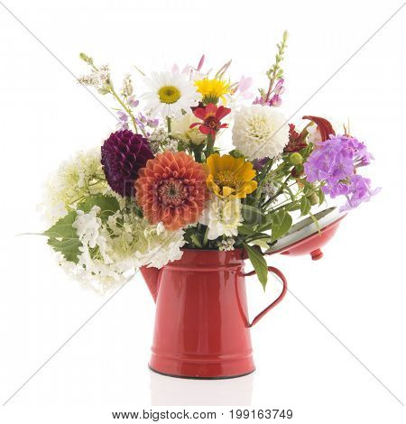 Bouquet colorful flowers in red vase isolated over white background