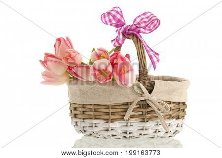 Little reed basket with bouquet pink tulips