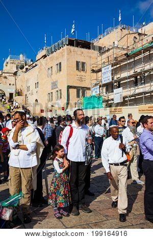 JERUSALEM, ISRAEL - OCTOBER 12, 2014:   Morning autumn Sukkot. Religious Jews have come to the Western wall of the Temple. Blessing Cohen in Sukkot