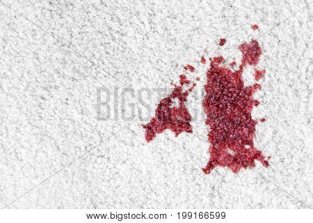 Spot of red wine on white carpet