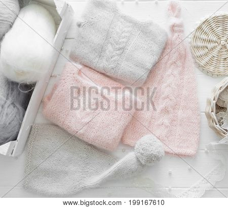 folded clothing for infants, hats and sweaters, topview