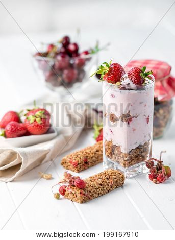 Tasty granola with nuts and yoghurt, sideview