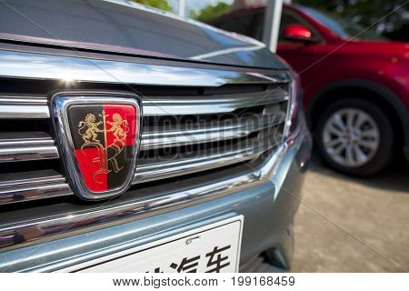 Dongguan, Guangdong, China - August 7, 2017: Closeup view of Roewe Chinese automobile on display at Dongguan car exhibition awaiting prospective buyers