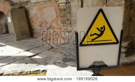 Warning Sign for Slippery floor with soft focus background