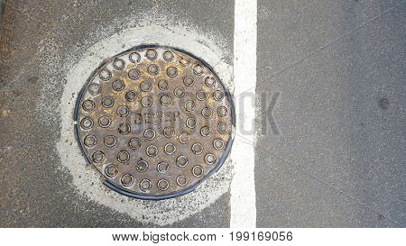 Sewer Manhole on Road