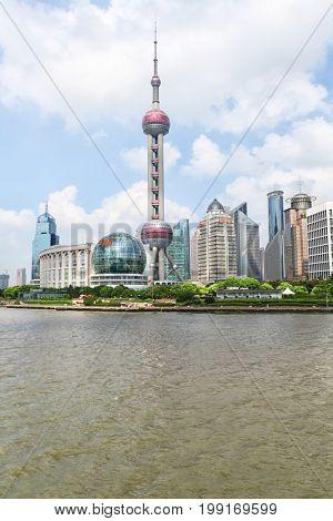 SHANGHAI – JULY 10, 2016:  urban landscape of office buildings in Lujiazui, Shanghai Bund
