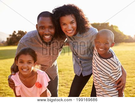 Portrait of smiling black family looking to camera outdoors