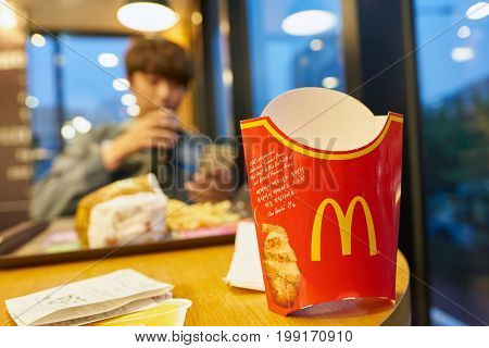 BUSAN, SOUTH KOREA - CIRCA MAY, 2017: close up shot of empty french fries box at McDonald's. McDonald's is an American hamburger and fast food restaurant chain.