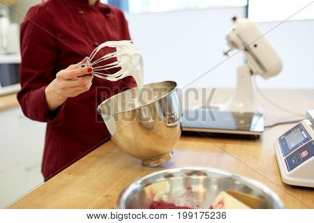 cooking, food and people concept - chef with whisk and whipped egg whites at kitchen