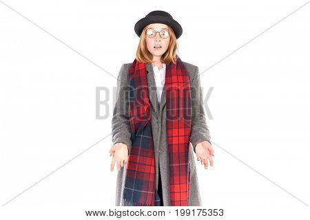 Portrait of teenage hispter girl wearing gray overcoat and black hat isolated on white