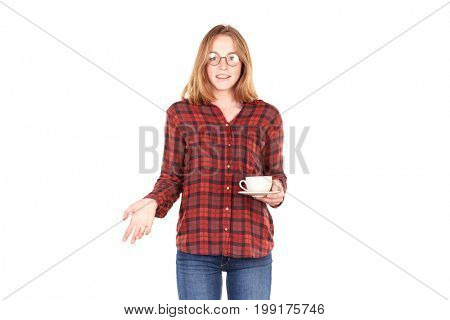 Portrait of red-haired college girl with coffee cup and saucer