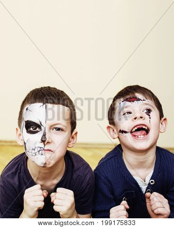 zombie apocalypse kids concept. Birthday party celebration facepaint on children dead bride, scar face, zombie skeleton together close up makeup emotional posing. halloween