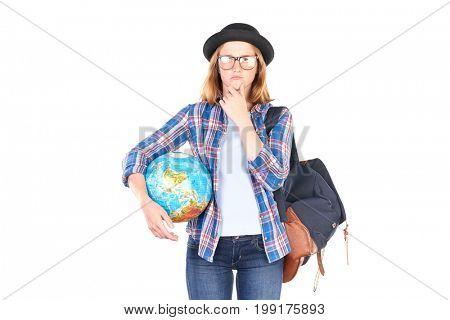 Female teenage student posing with globe against white background
