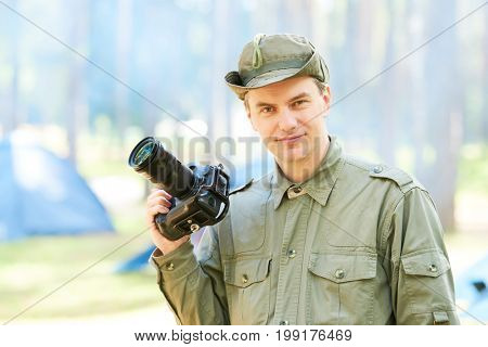 photographer with professional camera outdoors