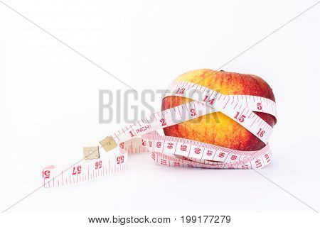 Red apple and measure The concept of weight control Lose Weight With Fruit Diet