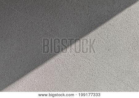 rough texture plaster on a wall of the hue sharkskin shaded diagonally