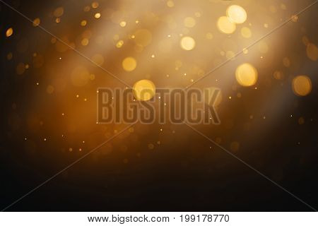 Bokeh circle abstract gold black and white effect with flow and glitter star snow celebration for christmas night party light pattern background texture.