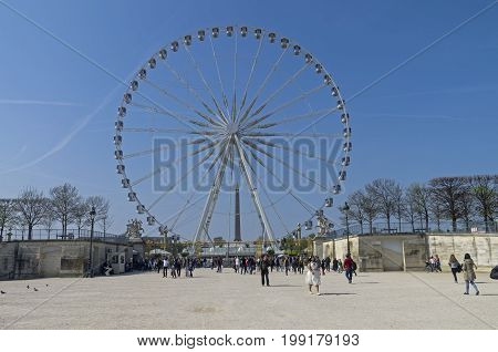 PARIS FRANCE - MARCH 26 2017: Ferris wheel at the Place de la Concorde in Paris. A sunny day in the end of March
