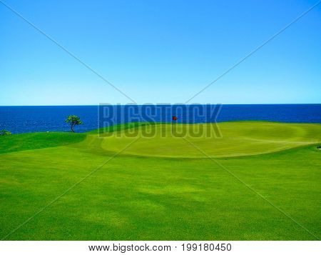 Seaside Golf Course Putting Green with skyline view of the water.