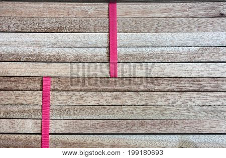 stack of wood timber background tied with red plastic ready to sell