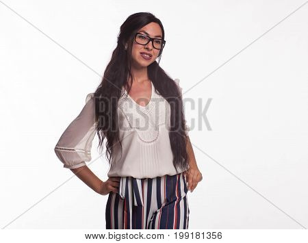 Young wistful woman portrait of a confident businesswoman showing by hands on a gray background. Ideal for banners, registration forms, presentation, landings, presenting concept.