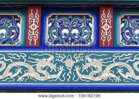 Decorative gate on Gerrard Street Chinatown London United Kingdom. Chinatown contains a number of Chinese restaurants bakeries supermarkets souvenir shops and other Chinese-run businesses.