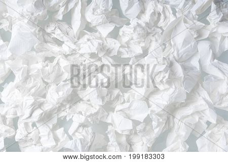 Many used screwed paper tissue isolated on white background