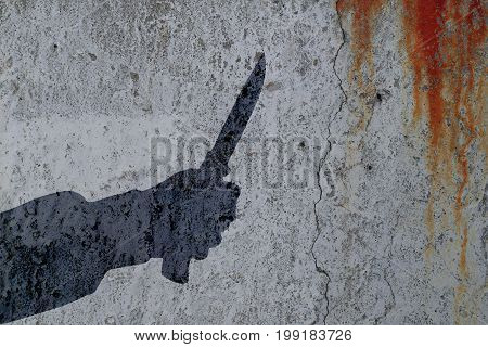 Shadow of human hand with killing knife on bloody wall background. Illustration for criminal news.