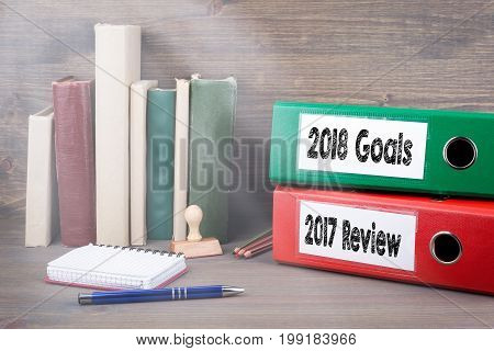2017 review and 2018 goals. Binders on desk in the office. Business background.