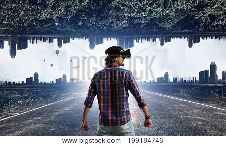 Man in virtual helmet . Mixed media